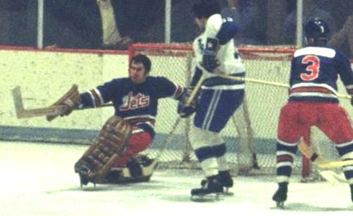 The Jets' Joe Daley was another maskless wonder when he first broke in in the WHA. Here he fends off a 1972 Houston attack