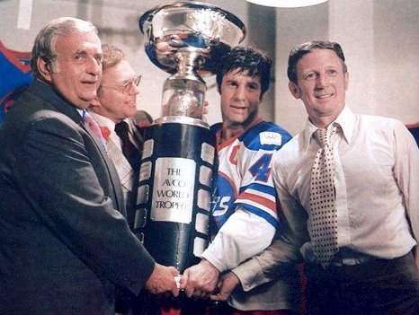 The Jets' Lars Eric Sjoeberg and league officials hoist the Avco Cup for the very last time
