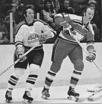 ron ward of the ny raiders tangles up ottawa's wayne carleton